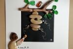 Cornice 3D nera con Api di sassi