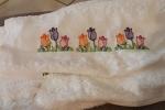 Asciugamano ricamato con matassine di qualità