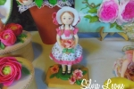 Bambola in pasta di ceramica