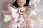 Bambola in pasta di mais, vestitino in raso rosa