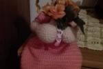 Bambola con fiori amigurumi