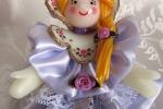 Bambolina in pasta di mais, vestitino in raso lilla