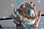 Bomboniere battesimo in gesso ceramico ali con bimbo