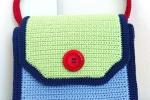 Borsetta multicolore, verde, azzurra, gialla, rossa e blu.