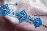 Bracciale al chiacchierino, cristalli, perle in Argento 925