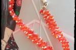 Braccialetto eseguito completamente a mano con perline arancioni e argento
