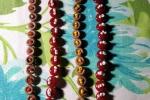 Braccialetti con bottoni e filo metallo