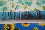 Bracciali rigidi in metallo con perline