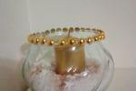 Centrotavola in vetro con candela con decori oro