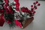 Centrotavola natalizio su ceppo