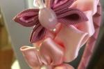 Cerchietto rosa con fiore e farfalla