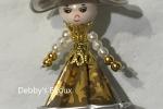Ciondolo bambolina realizzata con le capsule del caffè