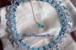 Collana al chiacchierino, filato argento, cristalli azzurri
