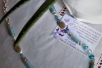 Collana azzurro cielo di strisce di carta
