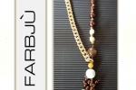 Collana catena dorata con perle bianche e marroni
