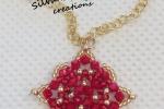 Collana con ciondolo con perline rosso e oro