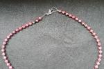 Collana con perline a rondella di color corallo