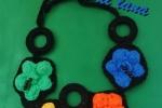 Collana fiori decorata con perline