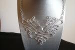 Collana con catenella in acciaio con lavorazione centrale in alluminio