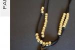 Collana Lunga doppio filo con ciondolo nero e oro
