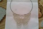Collana macrame con farfalla argento