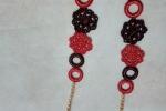 Collana realizzata in cotone colore rosso e nero laminato