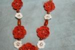 Collana realizzata in cotone colore arancio con fiorellini
