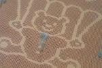 Copertina in cotone lavorato a uncinetto motivo orsetto
