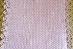 Copertina rosa realizzata all'uncinetto di caldo cotone
