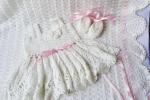 Corredino neonato, color bianco latte con fiocco rosa