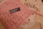Cuffietta neonata rosa in lana merinos