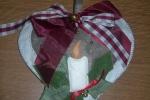 Cuore fuoriporta imbottito in feltro con candela natalizia