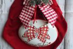 Decorazioni natalizie/Fiocco in velluto rosso con targa