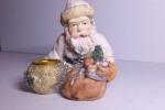Porta candela natalizio raffigurante Babbo Natale con sacco con i doni