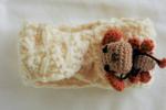 Fascia copri-orecchie panna per bimba con amigurumi