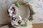 Ghirlanda in vimini decorata con orchidee realizzate a mano