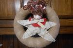 Ghirlanda fuoriporta di Natale yuta con bambola stellina