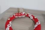 Ghirlanda natalizia in feltro con particolari in legno