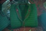 Gilet bimbo lavorato a uncinetto colore verde
