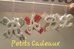 Lettere in polvere di ceramica si possono comporre nomi