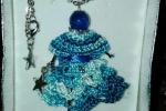 Bamboline create all'uncinetto con vestito vari colori