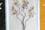 Mini pannello decorativo in stoffa d'arredo beige, sassi di mare