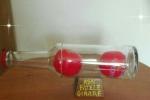 Bottiglia in vetro con palline