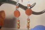 Orecchini in resina epossidica di colore marrone