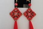 Orecchini in tessitura di perline color corallo