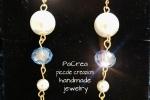 Orecchini pendenti con perle satinate e cristalli swarowske