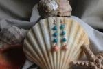 Orecchini pendenti con tre perline