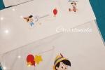 Pittura su stoffa di corredi per neonato