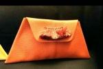 Pochette di pelle arancione