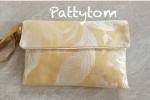 Pochette elegante artigianale in tessuto damascato